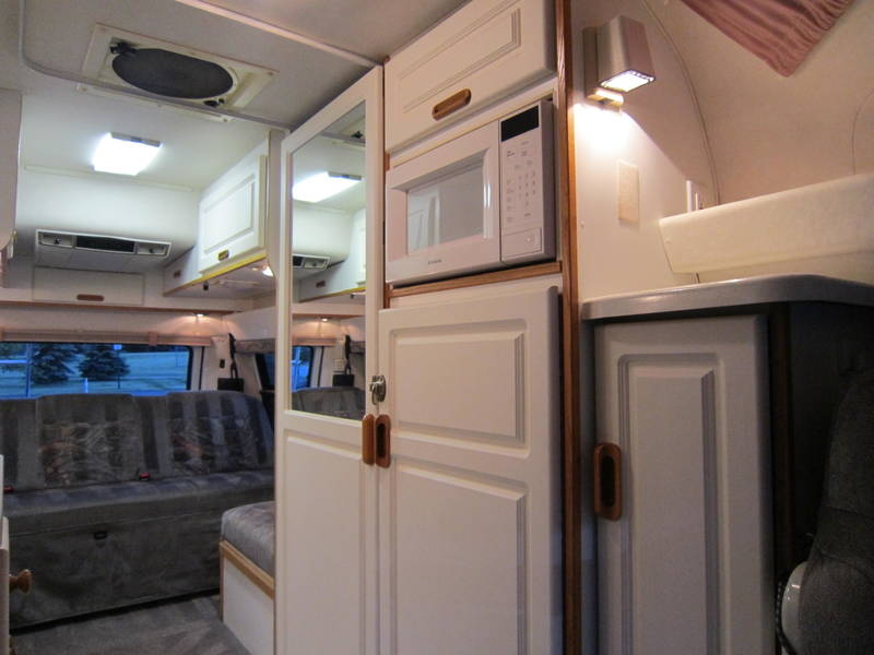 1998 Leisure Travel Freedom Wide Body Dodge Used RV Sale bugout shelter